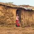 Young african girl from masai tribe in the doorway of her home — Stock Photo #59260431