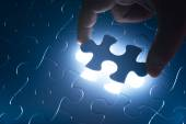 Missing jigsaw puzzle piece with light glow — Stock Photo