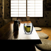 Glass of Green Tea on wood table — Stock Photo