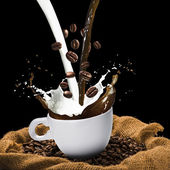 Coffee and Milk Splash from Cup — Stock Photo