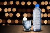 Water Bottle and Glass Of Ice Cubes — Stock Photo