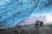 Happy couple in Ice cave — Stock Photo