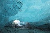 Tourist  in Ice cave in a glacier — Stock Photo