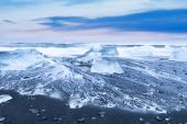 Ice beach with water wave — Stock Photo
