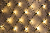 Closeup to Christmas Lights outside on a building — Stock Photo