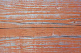 Texture of wall of rusty-red color boards with flaky paint — Stock Photo
