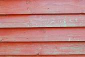 Texture of wall of red color boards with flaky paint — Stock Photo