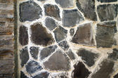 The wall of the large gray-brown stones close-up — Stock Photo
