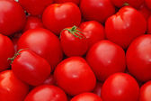 Red ripe tomatoes as background — Stock Photo