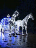 Decorative carriage with horses decorated with lights            — Stock Photo
