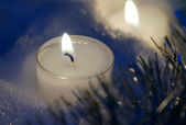 Candle in the snow at dusk — Stock Photo