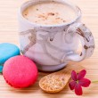 French colourful macaroons and a cup of coffee. - Macro shot wit — Stock Photo #70456699