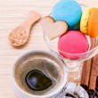 French colourful macaroons and a cup of coffee. - Macro shot wit — Stock Photo #70456793