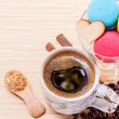 French colourful macaroons and a cup of coffee. - Macro shot wit — Stock Photo #70456795