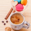 French colourful macaroons and a cup of coffee. - Macro shot wit — Stock Photo #70456803
