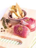 Row tenderloin with herbs on cutting board. - Steak preparing an — Stock Photo
