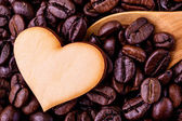 Coffee beans with wooden shape of heart. - Concept for love coff — Stock Photo