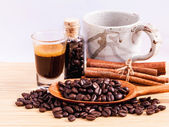 A Coffee cup and coffee beans on  wooden panel - With copy space — Stock Photo