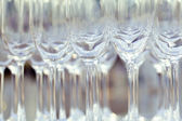 Empty wine glasses setting for wedding party. — Stock Photo