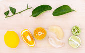 Mixed citruses fruit oranges, pomelo , lemon and lime on wooden — Stock Photo