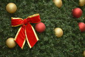 Red bow on the Christmas tree — Stock Photo