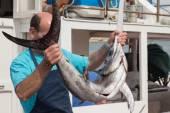 Fisherman with swordfish — Stock Photo