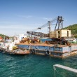 Industrial Crane mounted atop a barge in Greece — Stock Photo #67235459
