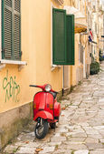 Red scooter on Greek street — Stock Photo