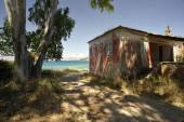 Deserted house set on a small beach  — Stock Photo