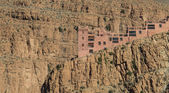 The house on the cliff of Gorges du Dades valley with small sola — Stock Photo