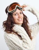 Portrait of young woman go in for winter sports over white backg — Stock Photo