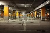 Image of parking garage underground interior, dark industrial bu — Stock Photo