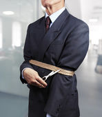 Image of businessman trying to get rid of fetters — Stock Photo