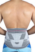 Bandage on the waist section of a young man — Stock Photo