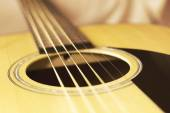 Guitar at the tissue background — Stockfoto
