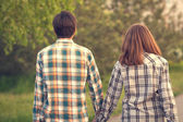 Man and woman walking hand in hand — Stock Photo