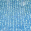 Hotel swimming pool with sunny reflections — Stock Photo #55645009