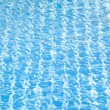 Hotel swimming pool with sunny reflections — Stock Photo #55645379