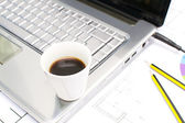 Computer and coffee in the office table — Stock Photo