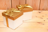 Gold gift boxes — Stock Photo