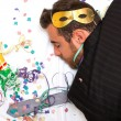 Young man sleeping after a party — Stock Photo #59018445