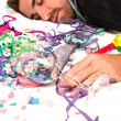 Young man sleeping after a party — Stock Photo #59100335