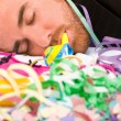 Young man sleeping after a party — Stock Photo #59427635