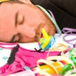 Young man sleeping after a party — Stock Photo #59427647