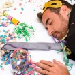 Young man sleeping after a party — Stock Photo #59452887
