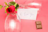 Crystal glasses and roses — Stock Photo