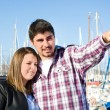Young woman and young man on a marina — Stock Photo #63399343