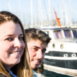 Young woman and young man on a marina — Stock Photo #63637821