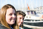 Young woman and young man on a marina — Stock Photo