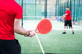 Friends playing paddle tennis — Foto Stock
